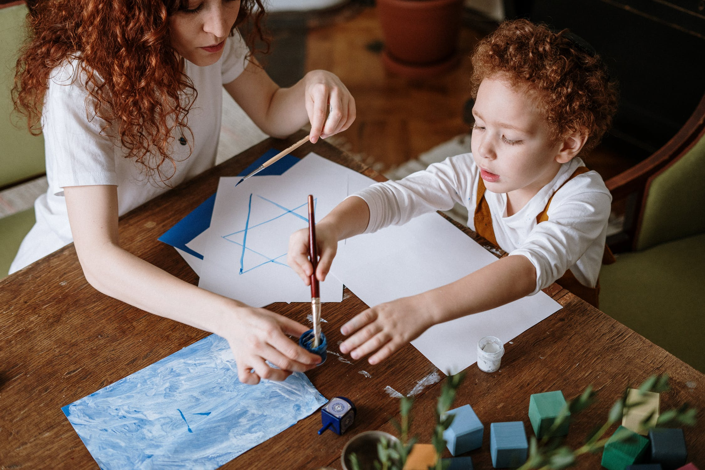Mom and Child create artwork together